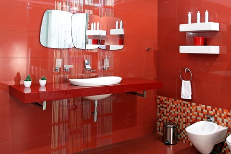 Modern bathroom with red ceramic walls and contemporary fixtures Stock Photo - 12418877