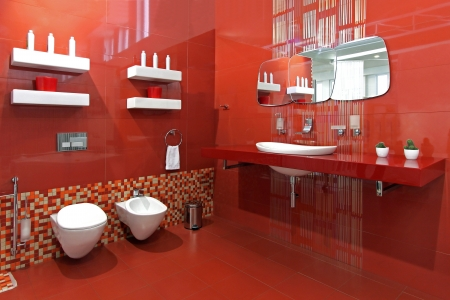 Modern bathroom with red ceramic walls and contemporary fixtures Stock Photo