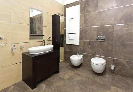 Modern bathroom interior with marble tiles and contemporary fixtures photo