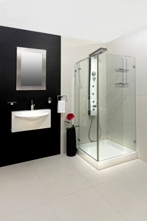 black bathroom: Modern bathroom with black and white tiles Stock Photo