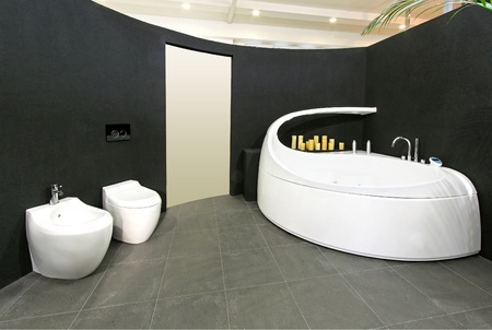 Modern bathroom with big bathtub and oval wall Stock Photo