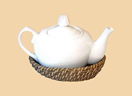 bushel: Classic ceramic teapot in rattan bushel isolated