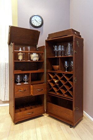 Wooden portable home bar with wheels in corner of room Stock Photo - 12662176