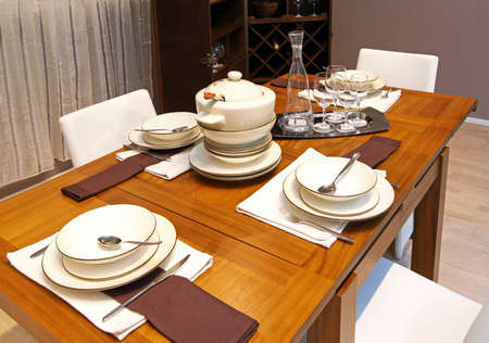 Modern wooden arranged dinning table in home interior