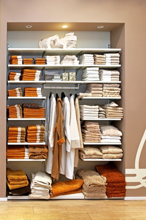 Big storage space with towels on shelf and bathrobes on hangers Stock Photo - 12662178
