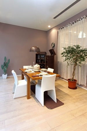 Modern dining room interior with wooden table photo