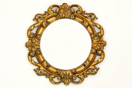 Oval gold baroque style frame on beige wall Stock Photo