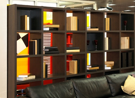 Wooden shelf with books in library interior photo