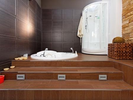 hydromassage: Modern bathroom interior with hydromassage bathtub and shower