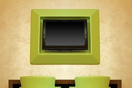 Large TV screen in modern interior with green chairs Stock Photo - 13333834