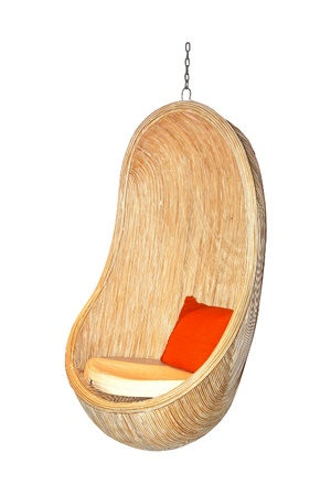 Rattan relaxing chair hanging froom ceiling isolated with clipping path included