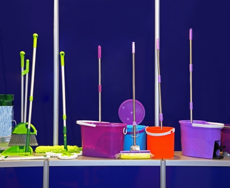 Set of cleaning equipment with plastic buckets and mops