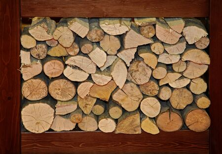 compartment: Large pile of firewood logs in big compartment