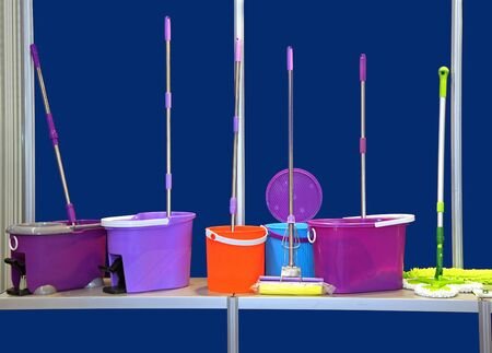 Set of cleaning equipment with plastic buckets and mops photo