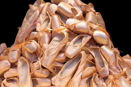 Large pile of proffessional female ballet shoes