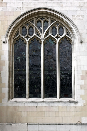 Large decorative church window with stained glass photo