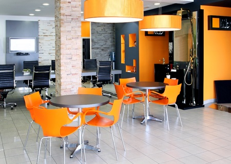 office space: Modern office space with bright orange furniture Stock Photo