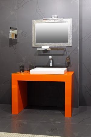 Modern bathroom interior with contemporary orange basin Stock Photo - 14227663