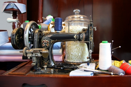 Retro sewing machine with thread and accessories photo