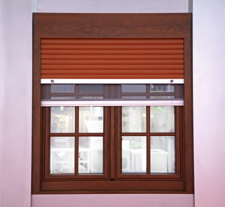 Closed window with brown blinds from outside photo