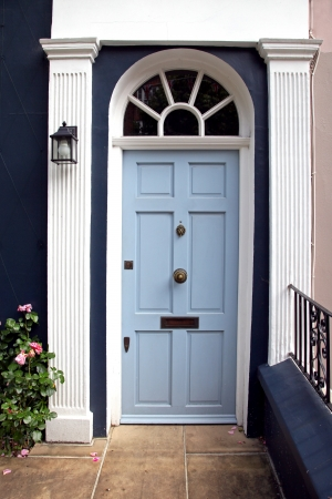 Blue entrance door in front of residential house Stock Photo