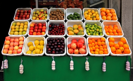 Big fruit stand in front of grocery store Stok Fotoğraf