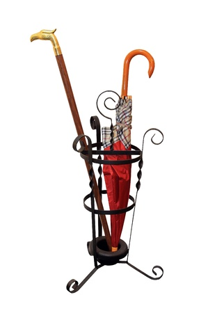 Iron umbrella stand with red umbrella isolated