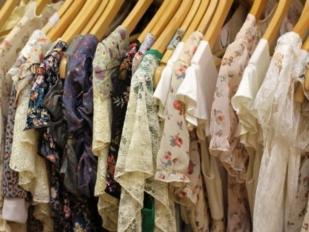 Floral design summer dresses on hangers on store rack Stock Photo - 16693257