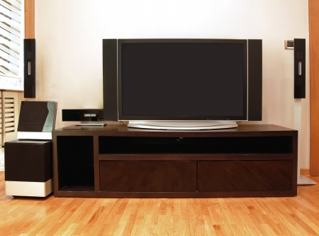 Home entertainment unit with plasma TV and surround speakers Stock Photo