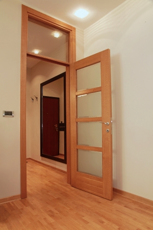 Home interior wooden door to corridor open photo