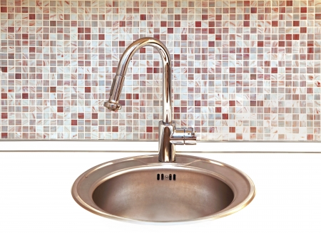 Modern kitchen faucet with mosaic tiles in background Stock Photo - 16684091