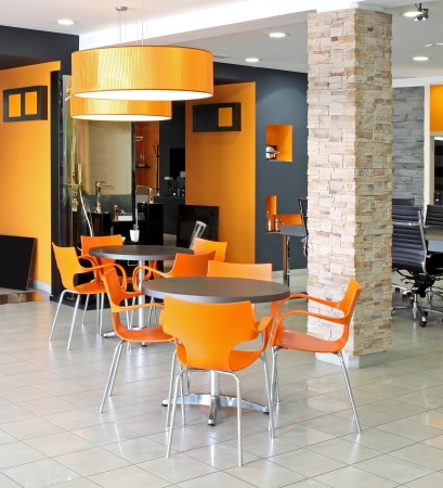 Small waiting area tables inside modern office space Stock Photo