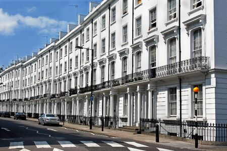London street row of residential houses with white facade