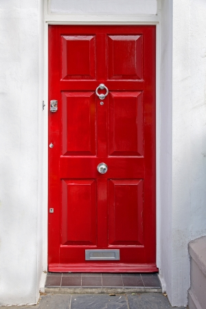 front of house: Red entrance door in front of residential house Stock Photo