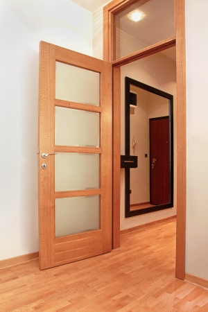 Home inter with open wooden door to corridor Stock Photo - 17153534