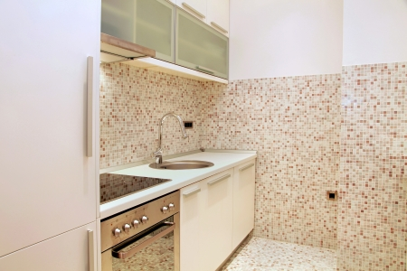 Modern kichen interiors with beige mosaic tiles