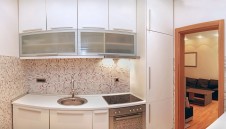 Small modern kitchen interior with beige tiles photo