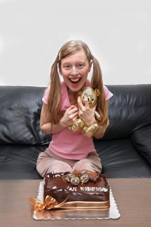 Teenage girl with birthday cake and teddy bear photo
