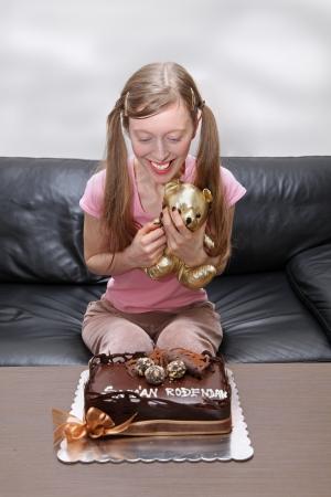 Teenage girl with birthday cake and teddy bear Stock Photo - 18063518