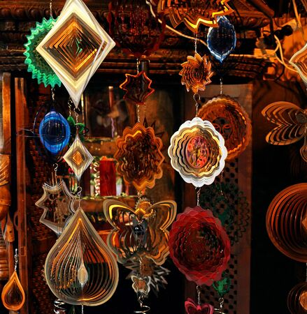 Shniy decor ornaments hanging from ceiling on market photo