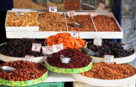 Organic dry fruits sold on market stall photo
