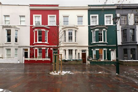 Small square with colorful residential houses in London during winter