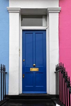 Retro blue door entrance on residential house Stock Photo