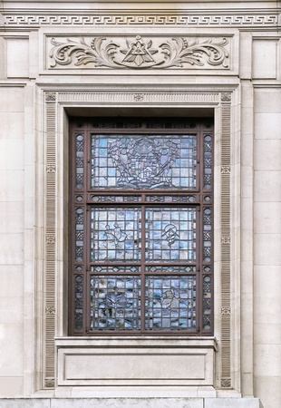 Glass window on old building with stone facade photo