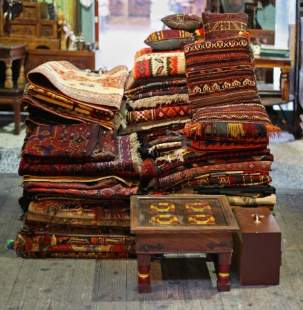 Traditional Moroccan rugs pile on old market