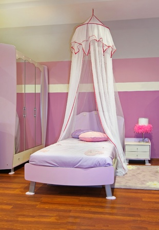 Modern girl bedroom interior with pink furniture photo