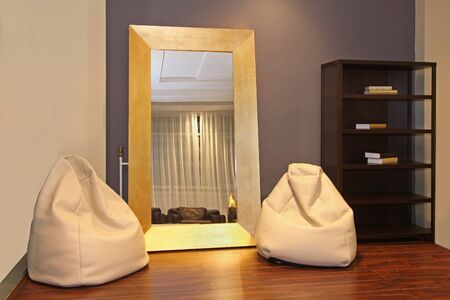 Modern room corner interior with lazy bags and mirror Stock Photo - 21001431