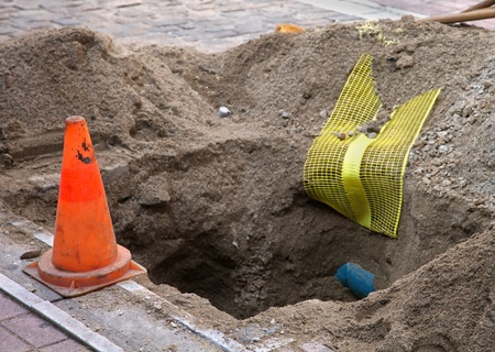 fibres: Hole dug out for placing optic fibres Stock Photo