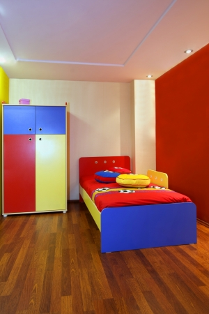 Modern child bedroom interior with colorful furniture