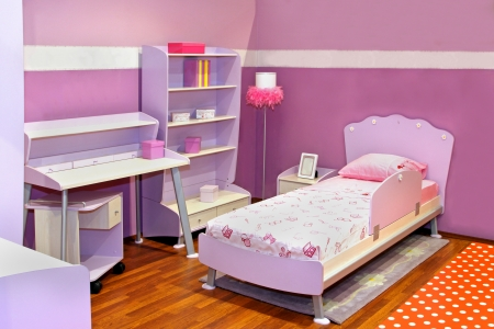 Modern child bedroom interior with pink furniture photo
